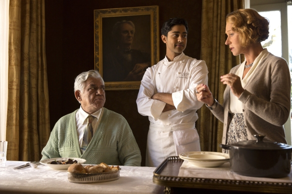 "Manish Dayal (center) plays a young chef, Hassan, in ""The Hundred-Foot Journey."" Here, a scene for which he likely power-posed. With co-stars Om Puri, who plays his father, and Helen Mirren, who plays the owner of a fancy French restaurant. Photo: Courtesy of Dreamworks"